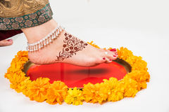Gruha Pravesh / Gruhapravesh / Griha Pravesh, closeup picture of right feet of a Newly married Indian Hindu bride dipping her fit Stock Photo
