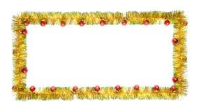 Grußkarte gemacht vom gelben und grünen Lamettarahmen mit roten Weihnachtsbällen Stockbild
