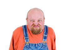 Grumpy. Man in overalls with grumpy face Stock Image