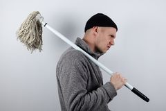 Grumpy, angry cleaner who is tired of his job stock images