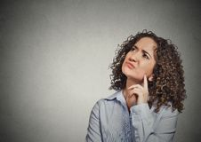 Grumpy annoyed unhappy young woman thinking looking up Stock Photo