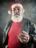 Grumpy badass Santa Claus Stock Photos