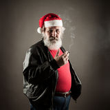 Grumpy badass Santa Claus. With cigarette Royalty Free Stock Images