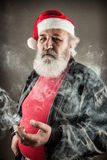 Grumpy badass Santa Claus. With cigarette royalty free stock photos