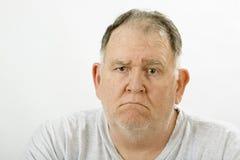 Grumpy big guy. Ragged and unshaven stock photo