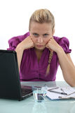 Grumpy blond office worker Royalty Free Stock Images
