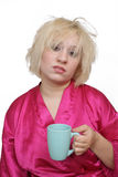 Grumpy Blonde with an Empty Coffee Cup (1) Royalty Free Stock Image