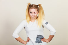 Grumpy blonde teenager girl with ponytails Stock Image