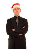 Grumpy Christmas Employee. A employee wearing a santa hat, looking grouchy stock photography