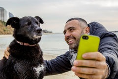 Grumpy dog taking selfie Royalty Free Stock Photography
