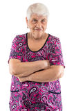 Grumpy elderly lady with arms crossed Stock Images