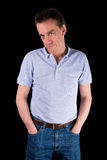 Grumpy Frowning Man with Hands in Pockets Stock Photography