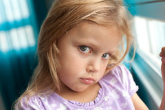 Grumpy girl. Portrait of a moody little girl Stock Photography