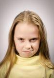 Grumpy girl Stock Image