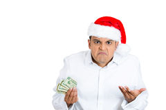 Grumpy greedy young man in santa claus hat Stock Images