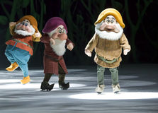 Grumpy, Happy and Doc Dwarves. GREEN BAY, WI - MARCH 10: Grumpy, Happy, and Doc Dwarves from Snow White in skates at the Disney on Ice Treasure Trove show at the Royalty Free Stock Images