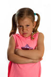 Grumpy little girl. Little girl with a grumpy face and folding her arms Royalty Free Stock Photo