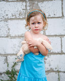 Grumpy Little Girl with Bunny Stock Photo