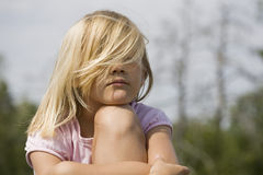 Grumpy looking young girl outdoors Stock Photography