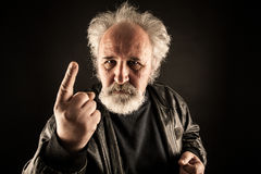 Grumpy man. Against black background Royalty Free Stock Image
