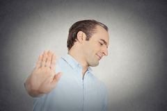 Grumpy man with bad attitude giving talk to hand gesture Royalty Free Stock Photos
