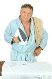 Grumpy Man Ironing Royalty Free Stock Photography
