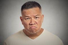 Grumpy man isolated on grey background Stock Photography
