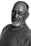 A grumpy middle aged man. Black & white portrait of a middle aged grumpy man royalty free stock image