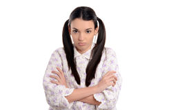 Grumpy in the morning. Beautiful young woman in pajamas upset standing with her hands crossed. Stock Photography