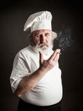 Grumpy old chef Stock Images