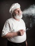 Grumpy old chef Stock Photos