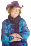 Grumpy Old Lady. Frowning old lady with folded arms over white Royalty Free Stock Photography