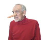 Grumpy old man wearing long false nose royalty free stock photos