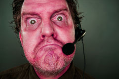 Grumpy Red Eyes and Face Customer Support Man with Headset Royalty Free Stock Photos