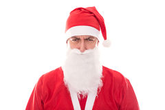 Grumpy Santa Claus looking to the Beholder, isolated on White, C. Oncept Christmas and santa´s little helper Royalty Free Stock Images