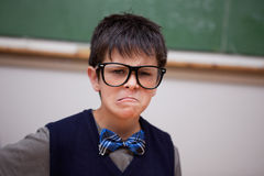 Grumpy schoolboy posing Royalty Free Stock Photo