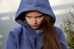 Grumpy teenage girl stock photos