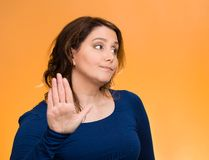 Grumpy woman with bad attitude, giving talk to my hand gesture Stock Photography
