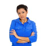 Grumpy woman. Closeup portrait of displeased pissed off angry grumpy young woman with bad attitude, arms crossed looking at you, isolated on white background Royalty Free Stock Images