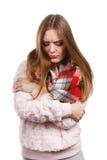 Grumpy woman feeling cold wearing warm scarf Stock Image