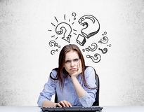 Grumpy woman with question marks Stock Images