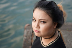 Grumpy young asian woman Royalty Free Stock Photography