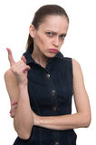 Grumpy young woman pointing finger upwards