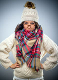Grumpy young woman in winter fashion Stock Photo