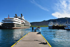 Grundarfjordur harbor. Fisher boats and a cruise liner in the harbor of Grundarfjordur, a small town with seafood manufacturing at Snaefellsnes peninsula royalty free stock photo