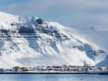 Grundarfjordur village, Iceland in winter. Grundarfjordur small coastal town in Snaefellsnes peninsula north side, Iceland, with snow covered mountains in the royalty free stock photography