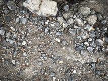 Grundbeschaffenheit des staubigen Felsens des Schmutzes Stockbilder