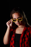 Grundge kid with a pair of yellow sunglasses Royalty Free Stock Photos