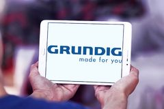 Grundig company logo. Logo of Grundig company on samsung tablet. Grundig is a German manufacturer of consumer electronics, domestic appliances and personal care royalty free stock photos