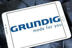 Grundig company logo. Logo of Grundig company on samsung tablet . Grundig is a German manufacturer of consumer electronics, domestic appliances and personal care stock photo